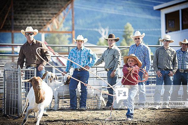 Ziege Capra aegagrus hircus unterrichten Junge - Person Cowboy Lasso Rodeo