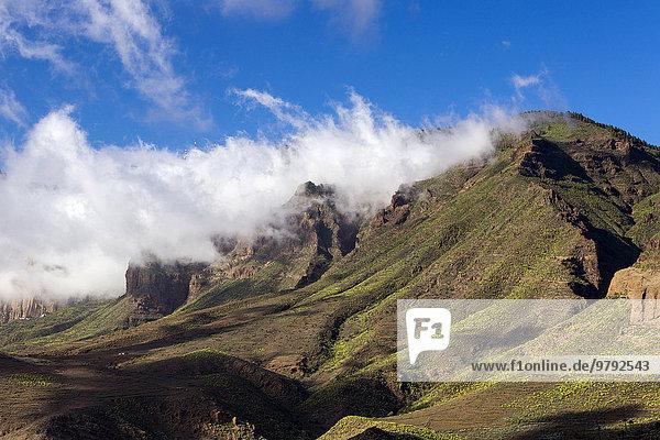 Wispy clouds over a mountain ridge  Santa Lucia de Tirajana  Gran Canaria  Canary Islands  Spain  Europe