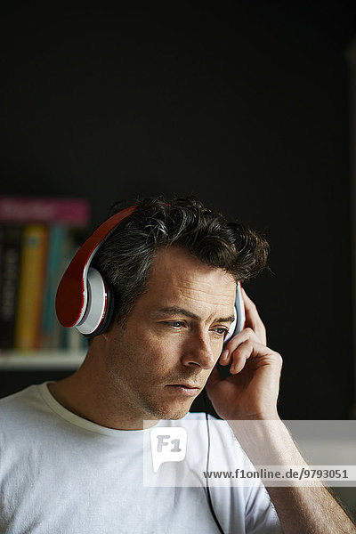 Man with headphones on listening