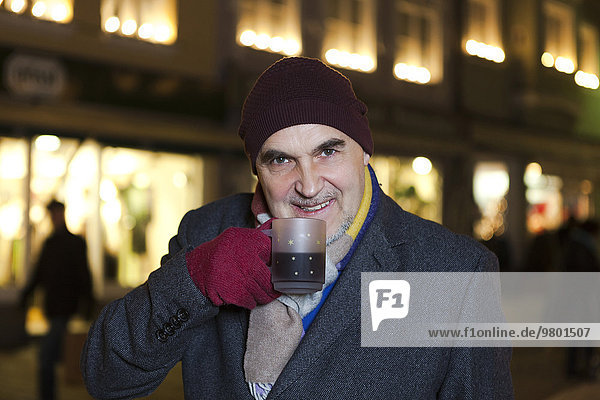 Senior man driking hot wine punch at Christmas Market  Bad Toelz  Bavaria  Germany