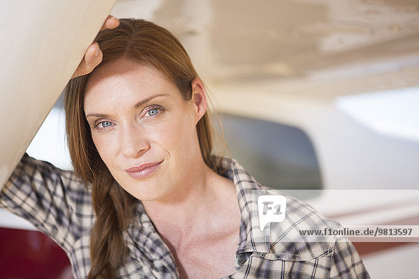 Woman standing beside plane