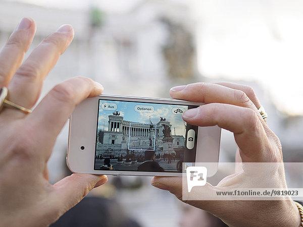 Italy  Rome  Woman taking photo of Vittoriano