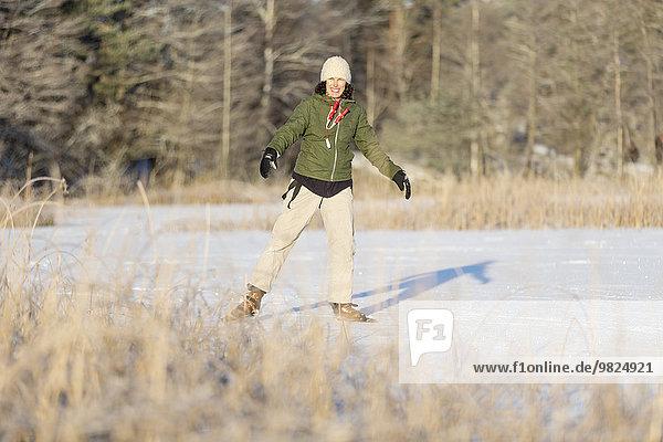 Mature woman ice-skating