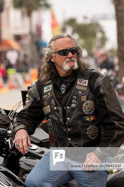 A bearded biker on Main Street during the 74th Annual Daytona Bike Week March 7  2015 in Daytona Beach  Florida.