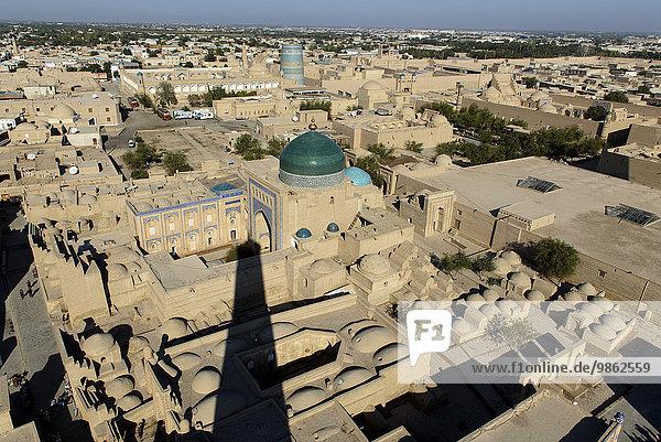 Kalta Minor and mausoleum with two domes  view from the Islomxoja minaret over historic centre Ichan Qala  UNESCO World Heritage Site  Khiva  Uzbekistan  Asia