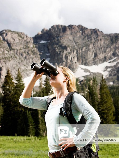 female hiker with binoculars