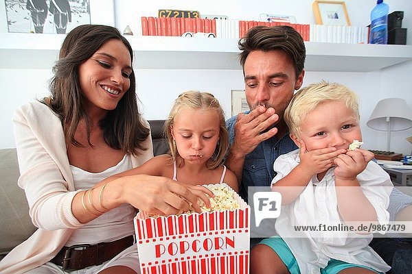 Family fun  eating popcorn