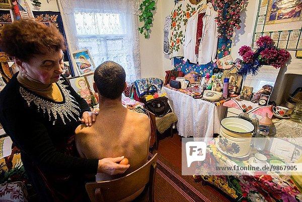 Milinchuk Halina  alternative medicine practitioner  heal her patient  rolling egg on his body and spelling Duo-theistic Pagan-Christian prayer  Koziatyn  Vinnytsia region  Ukraine.
