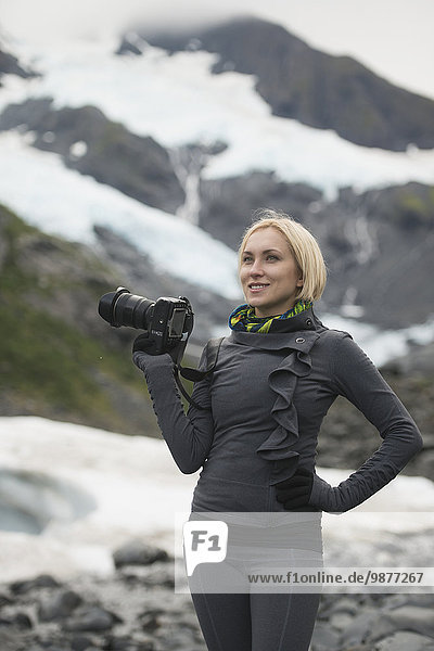 Female photographer with digital SLR  Portage Valley  Southcentral Alaska