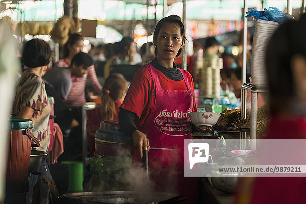 'Beautiful Cambodian young woman working in a small restaurant in the Old Market; Battambang  Cambodia'