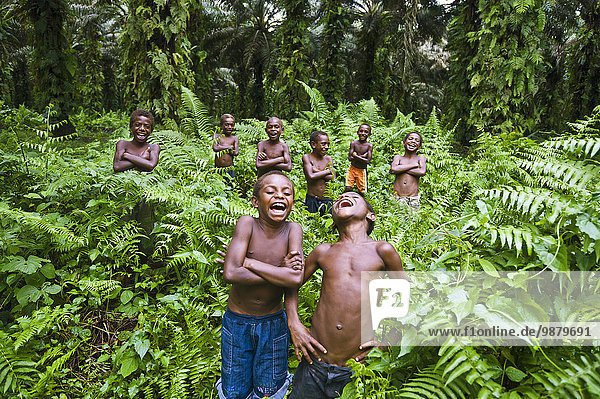 'Young boys laughing; West New Britain  Papua New Guinea'