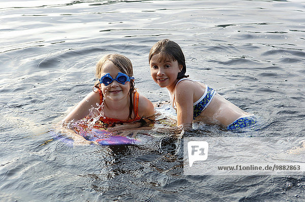 Girls  8 Years Old  Swimming In The Lake