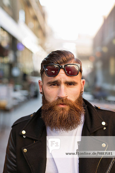 Portrait of bearded young man with sunglasses