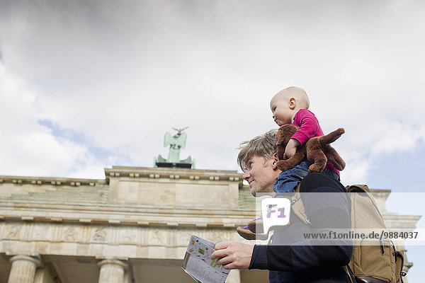Father sightseeing whilst giving baby daughter shoulder ride  Brandenburg Gate  Berlin  Germany