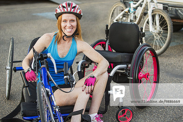 Woman with spinal cord injury cycling using hand propelled bicycle; Edmonton  Alberta  Canada