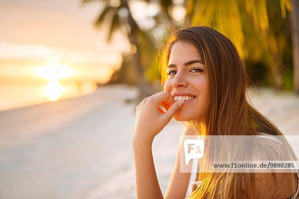 Portrait of young woman on Anda beach at sunset  Bohol Province  Philippines