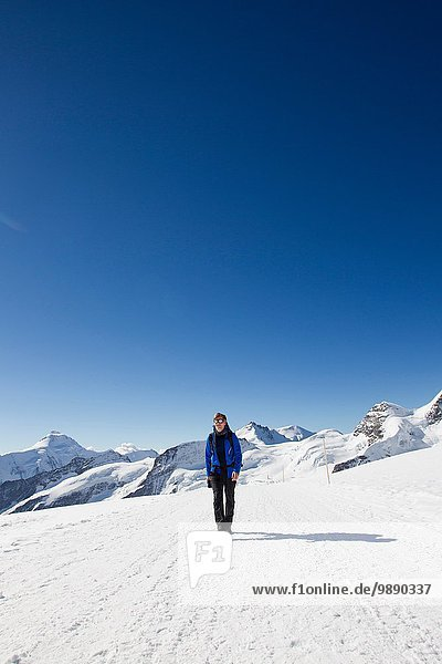 Male hiker hiking in snow covered landscape  Jungfrauchjoch  Grindelwald  Switzerland