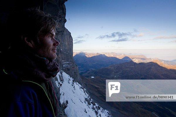 Close up of male hiker gazing at view  Jungfraujoch  Grindelwald  Switzerland