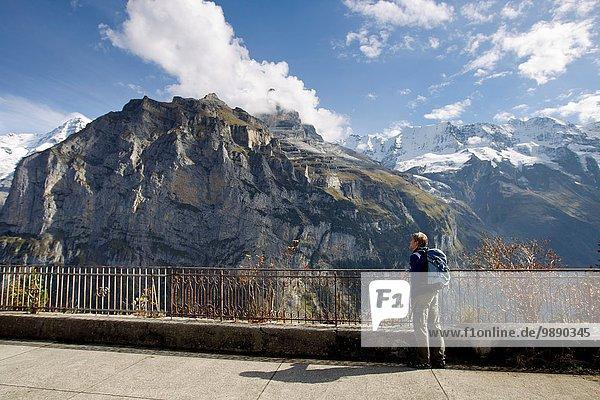 Male hiker gazing toward Nordwand of Mount Eiger  Murren  Grindelwald  Switzerland