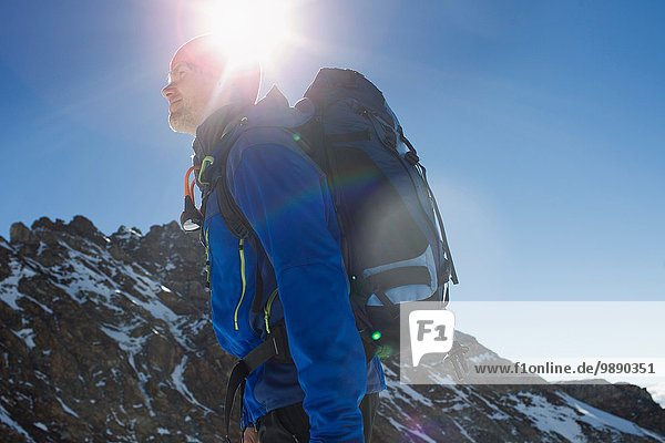 Low angle view of man hiking in mountains  Jungfrauchjoch  Grindelwald  Switzerland