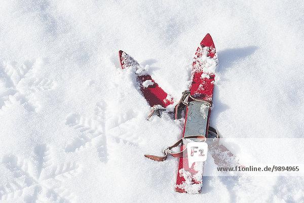 Germany,  pair of red children's ski on snow