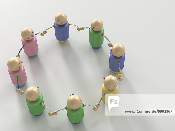 Figurengruppe im Kreis stehend  Händchen haltend