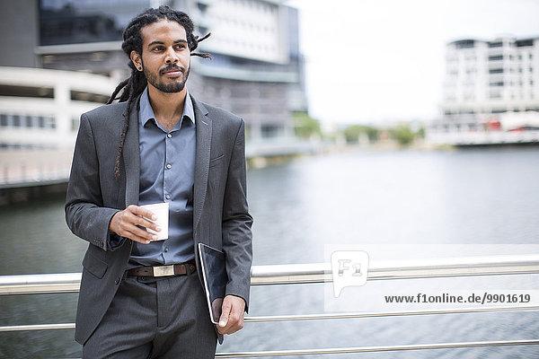 Businessman taking a break  drinking coffee