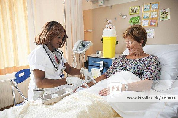 Nurse preparing a patient for an IV line