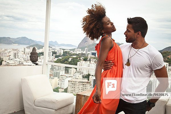 Couple dancing on terrace  Sugarloaf Mountain in background  Rio  Brazil
