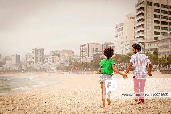 Couple enjoying beach  Rio de Janeiro  Brazil