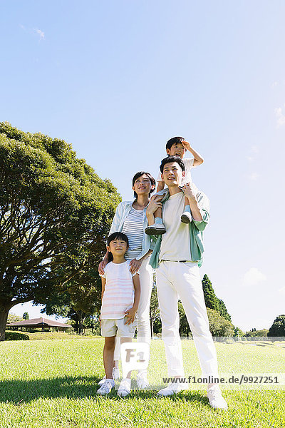 Happy Japanese family in a city park