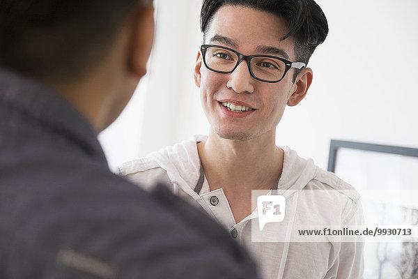 Close up of smiling men talking