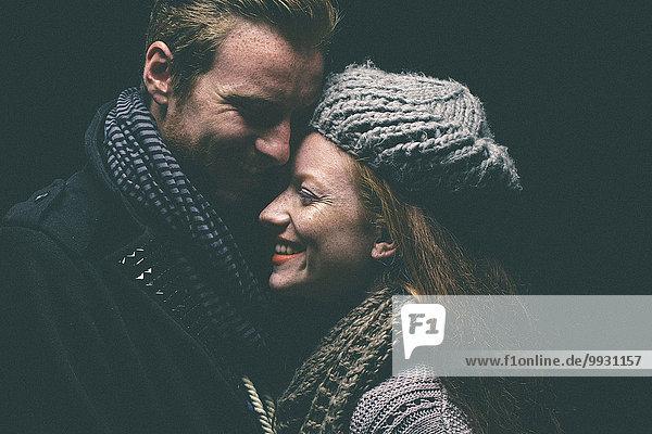 umarmen lächeln Wärme Kleidung