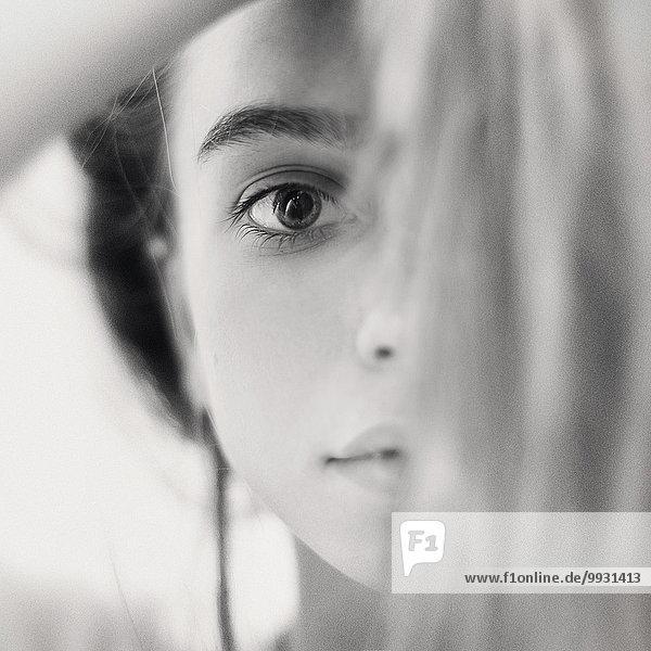 Close up of face of serious Caucasian girl