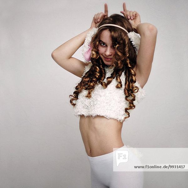 Caucasian girl wearing rabbit costume