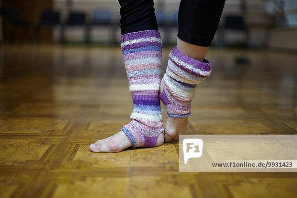 Caucasian dancer wearing leg warmers