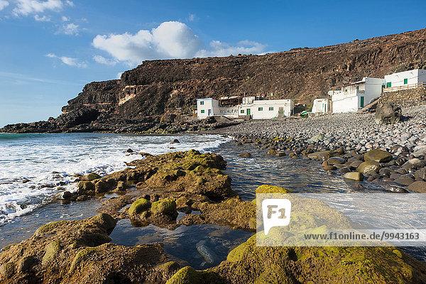 Felsbrocken Europa Stein Wohnhaus Gebäude Steilküste Küste Restaurant Kanaren Kanarische Inseln Fuerteventura Spanien
