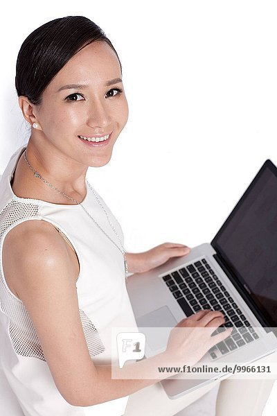 Young female white-collar workers using a laptop