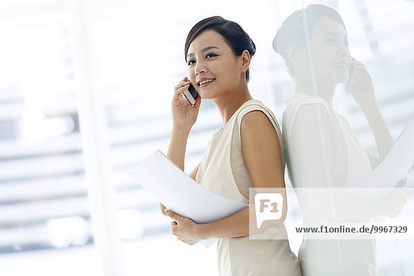 Young business woman calling