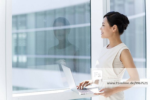 Young business lady with a computer