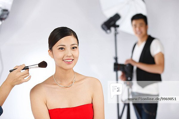 Staff for actresses makeup in the studio