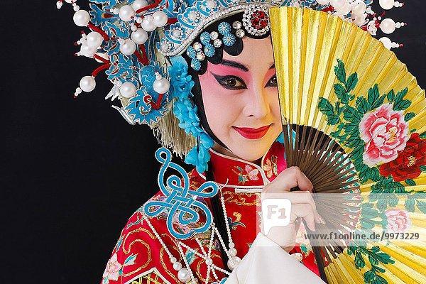 Female Peking Opera performer with a folding fan half block surface