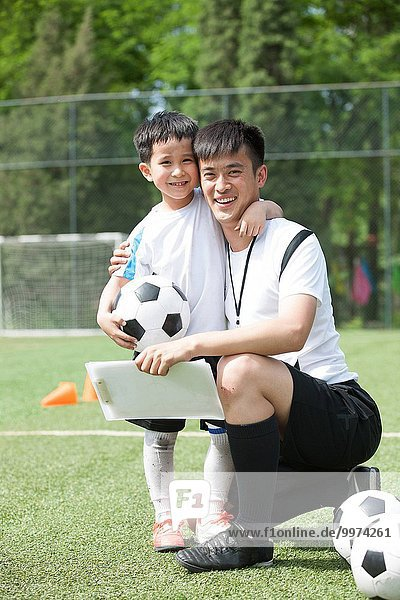 umarmen Junge - Person Football