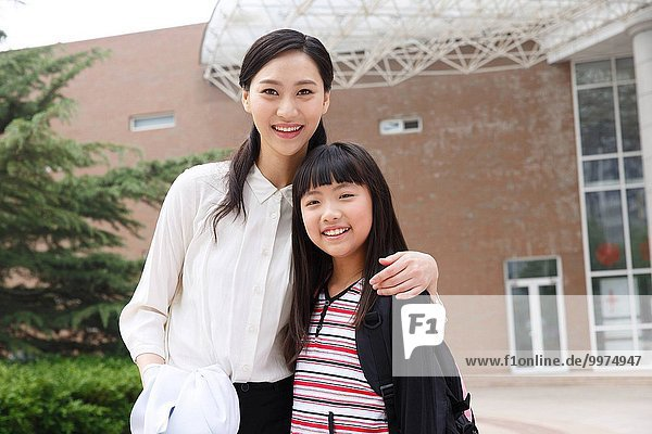 The mother and daughter at the school gate