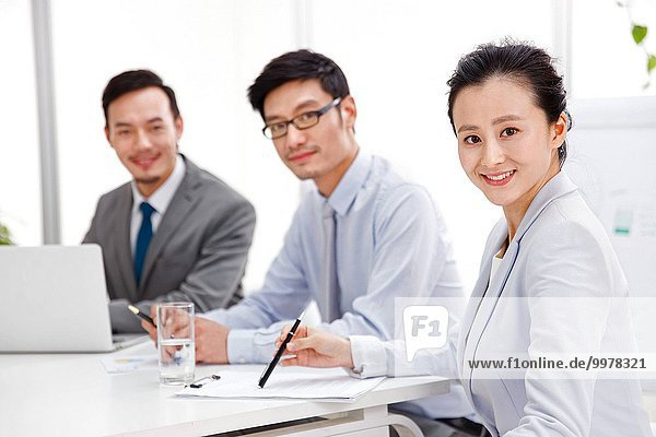 Business men and women work in the conference room