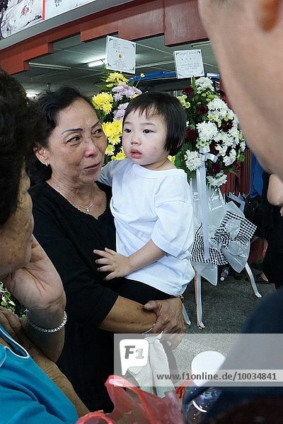The youngest daughter grieving with dad´s death. Sarawakian chinese funeral ceremony. Malaysia