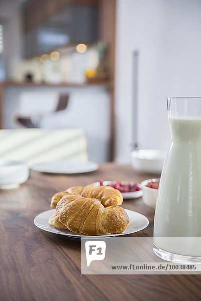 Croissants and milk for breakfast at dining table  Munich  Bavaria  Germany Croissants and milk for breakfast at dining table, Munich, Bavaria, Germany