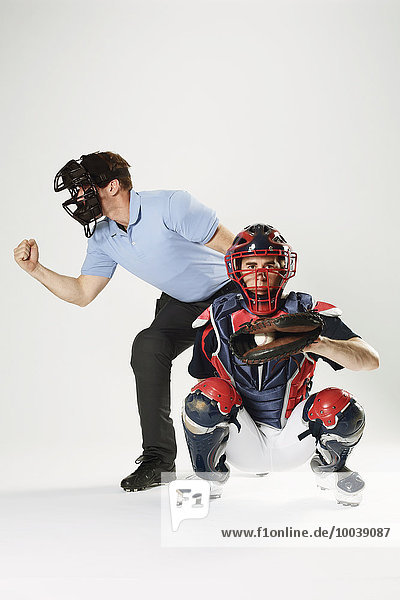 Baseball catcher and chief referee against white background