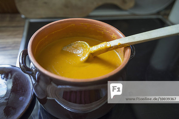 Pumpkin soup preparing on a gas stove  Munich  Bavaria  Germany