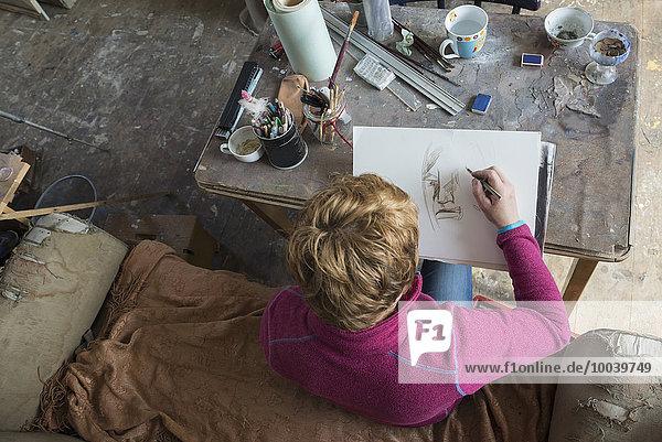 Female artist making sketch in art studio  Bavaria  Germany